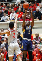 Kent State forward Danny Pippen, right, goes up to shoot in front of Ohio State guard D.J. Carton during the first half of an NCAA college basketball game in Columbus, Ohio, Monday, Nov. 25, 2019. (AP Photo/Paul Vernon)