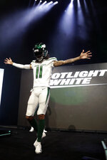 "New York Jets wide receiver Robby Anderson models the NFL football team's new ""spotlight white"" uniform Thursday, April 4, 2019, in New York. (AP Photo/Julio Cortez)"