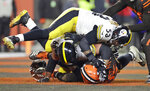 Cleveland Browns defensive end Myles Garrett, bottom, and, Pittsburgh Steelers center Maurkice Pouncey (53) and offensive guard David DeCastro (66) fall to the turf during a brawl in the second half of an NFL football game Thursday, Nov. 14, 2019, in Cleveland. The Browns won 21-7. (AP Photo/Ron Schwane)