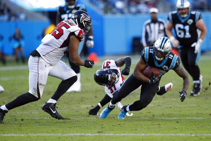 Atlanta Falcons free safety Ricardo Allen (37) and defensive tackle Jack Crawford (95) chase Carolina Panthers wide receiver D.J. Moore (12)nduring the second half of an NFL football game in Charlotte, N.C., Sunday, Nov. 17, 2019. (AP Photo/Brian Blanco)