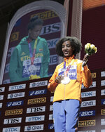 Sifan Hassan of the Netherlands, gold winner, poses during the medal ceremony for the women's 10,000m final at the World Athletics Championships in Doha, Qatar, Sunday, Sept. 29, 2019. (AP Photo/Nariman El-Mofty)