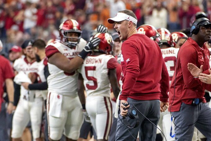 Oklahoma head coach Lincoln Riley celebrates after his team scored a touchdown against Texas at the end of the first half of the Big 12 Conference championship NCAA college football game on Saturday, Dec. 1, 2018, in Arlington, Texas. (AP Photo/Jeffrey McWhorter)