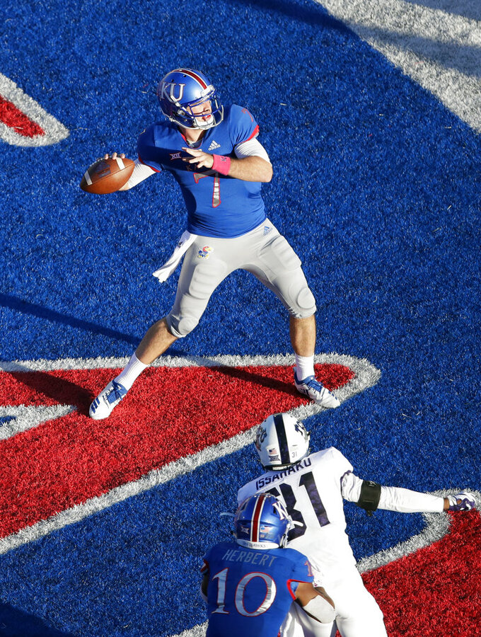 Kansas quarterback Peyton Bender (7) prepares to throw the ball out the back of the end zone for a safety late in the second half of an NCAA college football game against TCU in Lawrence, Kan., Saturday, Oct. 27, 2018. (AP Photo/Orlin Wagner)