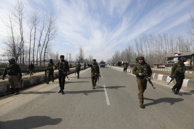 Indian police and paramilitary soldiers block a road leading towards the site of a brief gun-battle with suspected rebels on the outskirts of Srinagar, Indian controlled Kashmir, Wednesday, Feb. 5, 2020. Two suspected rebels and an Indian paramilitary soldier were killed in brief fighting in disputed Kashmir on Wednesday, officials said. Government forces detained a suspected militant after the fighting. (AP Photo/ Umer Asif)