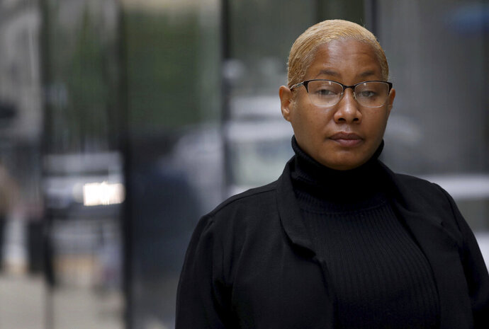 Chicago police Officer Cynthia Donald stands outside her lawyer's downtown Chicago office, Thursday, Oct 15, 2020. Johnson has filed a lawsuit Thursday alleging sexual assault by former police Superintendent Eddie Johnson, who was out drinking with her the night he was found asleep behind the wheel of his SUV. (Antonio Pere/Chicago Tribune via AP)