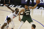 Milwaukee Bucks' Giannis Antetokounmpo (34) is defended by Los Angeles Clippers' Patrick Beverley (21) during the first half of an NBA basketball game Wednesday, Nov. 6, 2019, in Los Angeles. (AP Photo/Marcio Jose Sanchez)