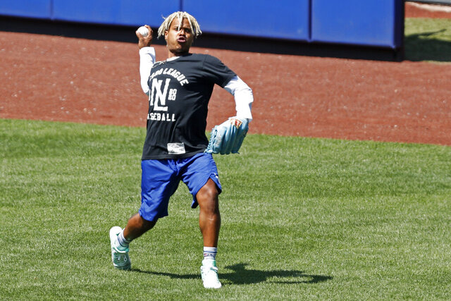 New York Mets starting pitcher Marcus Stroman throws in the outfield during baseball practice at Citi Field, Thursday, July 16, 2020, in New York. (AP Photo/Kathy Willens)