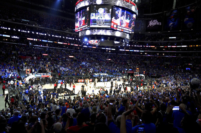FILE - In this June 18, 2021, file photo, Los Angeles Clippers fans cheer in the final moments of the Clippers' 131-119 win over the Utah Jazz in Game 6 of the second-round of the Western Conference the NBA basketball playoffs. California will tighten its rules for indoor events starting Sept. 20, 2021, requiring either proof of vaccination or a negative coronavirus test for gatherings of 1,000 people or more as new virus cases continue to climb because of the delta variant. (Keith Birmingham/The Orange County Register via AP, File)