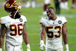 Washington Football Team inside linebacker Jon Bostic (53) and defensive end James Smith-Williams (96) leave the field after an NFL football game against the San Francisco 49ers, Sunday, Dec. 13, 2020, in Glendale, Ariz. Washington won 23-15. (AP Photo/Ross D. Franklin)