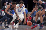 Memphis guard Jayden Hardaway (25) scrambles for a loose ball under pressure by the Connecticut's Brendan Adams, left, and Isaiah Whaley during an NCAA college basketball game, Saturday, Feb. 1 2020, at the FedExForum in Memphis, Tenn. (Jim Weber/Daily Memphian via AP)