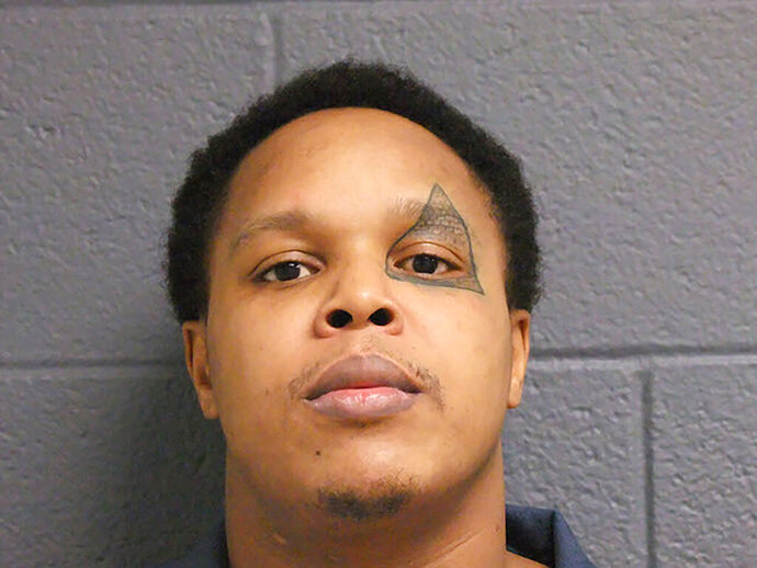 This Oct. 26, 2017, photo provided by the Michigan Department of Corrections shows Alex Lavell Rawls. Authorities said that Rawls faces home invasion charges from an incident Wednesday, Nov. 6, 2019, where he was fended off by a replica battle ax. (Michigan Department of Corrections via AP)