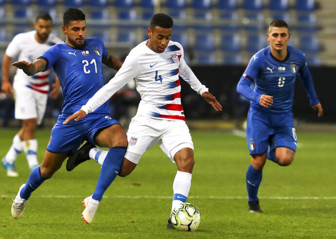 FILE - In this Tuesday, Nov. 20, 2018 file photo, Italy's Emerson (21), United States' Tyler Adams (4) and Italy's Marco Verratti (6) fight for the ball during the international friendly soccer match at the Cristal Arena in Genk, Belgium. American midfielder Tyler Adams has recovered from an adductor injury that has sidelined him for more than a month and could play in RB Leipzig's Bundesliga finale this weekend. The 20-year-old is available for Saturday's match at Werder Bremen, Leipzig said Thursday, May 16, 2019. (AP Photo/Francisco Seco, File)