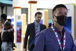 A visitor wears a mask at the Arab Health Exhibition in Dubai, United Arab Emirates, Wednesday, Jan. 29, 2020. The United Arab Emirates on Wednesday confirmed the first cases in the Mideast of the new Chinese virus that causes flu-like symptoms, saying doctors now were treating a family that had just come from a city at the epicenter of the outbreak.  (AP Photo/Kamran Jebreili)