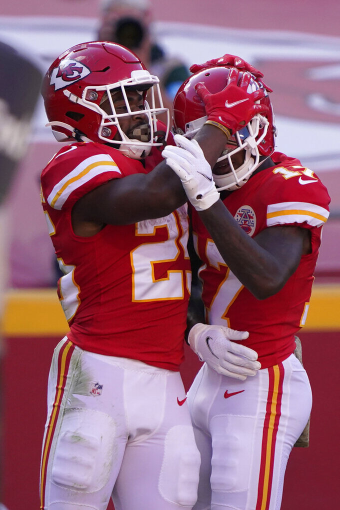Kansas City Chiefs running back Clyde Edwards-Helaire, left, is congratulated by Mecole Hardman after scoring against the Carolina Panthers during the second half of an NFL football game in Kansas City, Mo., Sunday, Nov. 8, 2020. (AP Photo/Jeff Roberson)