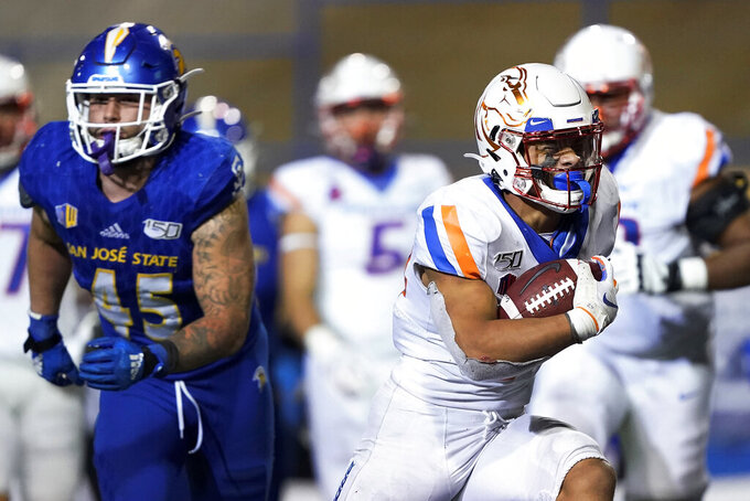 Boise State running back George Holani (24) rushes for a touchdown past San Jose State linebacker Kyle Harmon (45) during the second half of an NCAA college football game, in San Jose, Calif., Saturday, Nov. 2, 2019. Boise State won 52-42. (AP Photo/Tony Avelar)