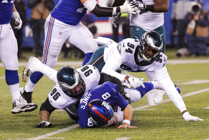 New York Giants quarterback Daniel Jones (8) is sacked by Philadelphia Eagles defensive end Derek Barnett (96) in the second half of an NFL football game, Sunday, Dec. 29, 2019, in East Rutherford, N.J. (AP Photo/Seth Wenig)