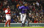Colorado Rockies' Nolan Arenado watches his two-run home run against the Boston Red Sox during the seventh inning of a baseball game Tuesday, May 14, 2019, at Fenway Park in Boston. (AP Photo/Winslow Townson)