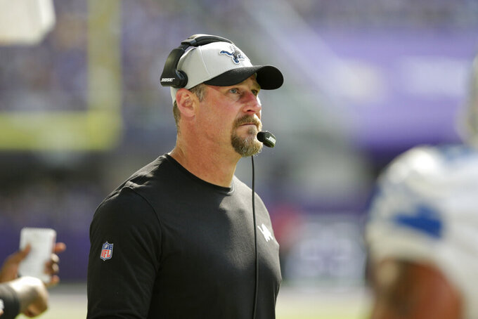 Detroit Lions head coach Dan Campbell watches from the sideline during the first half of an NFL football game against the Minnesota Vikings, Sunday, Oct. 10, 2021, in Minneapolis. (AP Photo/Andy Clayton-King)