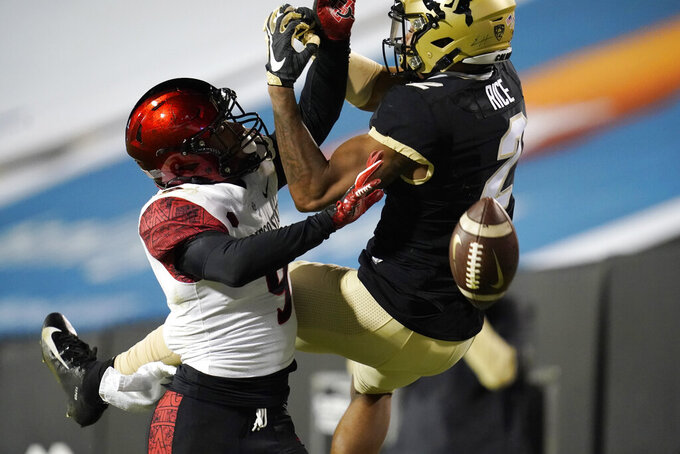 San Diego State safety Tayler Hawkins, left, breaks up a pass intended for Colorado wide receiver Brenden Rice during the second half of an NCAA college football game Saturday, Nov. 28, 2020, in Boulder, Colo. (AP Photo/David Zalubowski)