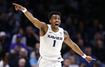 Xavier guard Paul Scruggs directs teammates during the second half of an NCAA college basketball game against St. John's, Sunday, Jan. 5, 2020, in Cincinnati. (AP Photo/Gary Landers)