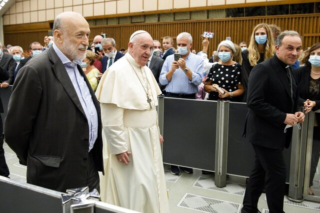 "Pope Francis walks next to Carlo Petrini during an audience at the Vatican, Saturday, Sept. 12, 2020. Pope Francis has formed an unusual partnership with the agnostic former communist founder of the Slow Food movement to double down on his calls to protect the environment from profit-driven development that Francis says is harming the poorest most. Francis on Saturday welcomed Carlo Petrini to the Vatican and met with participants of a committee Petrini formed to help put into practice Francis' appeals for environmental sustainability and solidarity articulated in his 2015 encyclical ""Laudato Sii"" (Praised Be). (Vatican Media via AP)"
