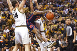 Auburn's J'Von McCormick, right, passes around Missouri's Reed Nikko, left, during the first half of an NCAA college basketball game Saturday, Feb. 15, 2020, in Columbia, Mo. (AP Photo/L.G. Patterson)