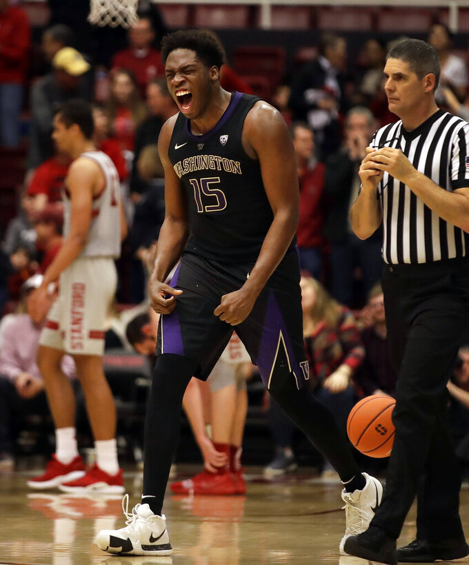 Washington's Noah Dickerson (15) celebrates after the defeat of Stanford at the end of an NCAA college basketball game Sunday, March 3, 2019, in Stanford, Calif. (AP Photo/Ben Margot)