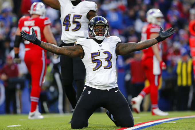 Baltimore Ravens defensive end Jihad Ward (53) celebrates on the field during the second half of an NFL football game against the Buffalo Bills in Orchard Park, N.Y., Sunday, Dec. 8, 2019. The Ravens won 24-17. (AP Photo/John Munson)