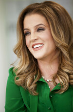 FILE - In this Thursday, May 10, 2012, file photo, singer Lisa Marie Presley poses for a photo in West Hollywood, Calif. An exhibit centered on the career of Lisa Marie Presley is among the highlights of 2018's Elvis Week in Memphis, Tenn. (AP Photo/Damian Dovarganes, File)