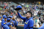 Seattle Mariners pitcher Felix Hernandez, who made his last start days earlier, waves to fans from the dugout between innings of a baseball game against the Oakland Athletics Sunday, Sept. 29, 2019, in Seattle. (AP Photo/Elaine Thompson)