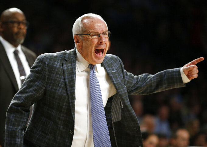 North Carolina head coach Roy Williams reacts during the second half of an NCAA college basketball game against Georgia Tech in Atlanta, Tuesday, Jan. 29, 2019. (AP Photo/Todd Kirkland)