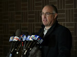 Singer R. Kelly's attorney Steve Greenberg speaks to the media after Kelly turned himself in to police Friday, Feb. 22, 2019, in Chicago. R. Kelly was taken into custody after arriving Friday night at a Chicago police precinct, hours after authorities announced multiple charges of aggravated sexual abuse involving four victims, including at least three between the ages of 13 and 17. (AP Photo/Paul Beaty)