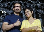"FILE - In this March 14, 2018 file photo, Bollywood actor Aamir Khan stands wife his wife Kiran Rao at their residence in Mumbai, India. On October 10, actor and heavyweight Bollywood producer Aamir Khan and his wife Kiran Rao put out a statement saying that they were ""committed to doing any and everything to make our film industry a safe and happy one to work in."" In a Tweet, Khan said they were about to begin work with someone who has been accused of sexual misconduct and the matter is pending in court. (AP Photo/Rajanish Kakade, File)"