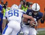 Kentucky linebacker Kash Daniel (56) sacks Penn State quarterback Trace McSorley during the first half of the Citrus Bowl NCAA college football game, Tuesday, Jan. 1, 2019, in Orlando, Fla. (AP Photo/John Raoux)