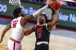 Rutgers center Myles Johnson (15) blocks a shot by Nebraska forward Derrick Walker (13) in the first half during an NCAA college basketball game Monday, March 1, 2021, in Lincoln, Neb. (AP Photo/John Peterson)