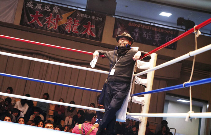 This undated photo provided by 2020 UNDERDOG FILM PARTNERS shows film director Masaharu Take at the movie set of Underdog. Take's films have always focused on painful stories about Japan's