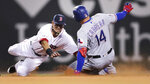 Boston Red Sox second baseman Marco Hernandez, left, dives to tag out Texas Rangers' Asdrubal Cabrera (14), who tried to advance to second on his single, during the sixth inning of a baseball game at Fenway Park in Boston, Tuesday, June 11, 2019. (AP Photo/Charles Krupa)