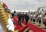 President of the Sudanese Transitional Council General Abdel Fattah al-Burhan, right, inspects an honor guard with Eritrean President Isaias Afwerki on his arrival at the Khartoum airport in Khartoum, Sudan, Tuesday, May 4, 2021. Eritrea's president arrived in Khartoum on Tuesday for talks with Sudanese officials amid tensions between the two countries over the Tigray conflict on Sudan's border. (AP Photo/Marwan Ali)