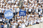 FILE - In this Sept. 16, 2017, file photo, BYU fans cheer in the first half during an NCAA college football game against Wisconsin, in Provo, Utah. The friendly confines of LaVell Edwards Stadium will have fans for the first time this season when No. 12 BYU faces Texas State on Saturday., Oct. 24, 2020. Cougars coach Kalani Sitake has a message for the approximately 6,000 who show up: Be loud. Be very, very loud. Make it seem like 60,000.(AP Photo/Kim Raff, File)