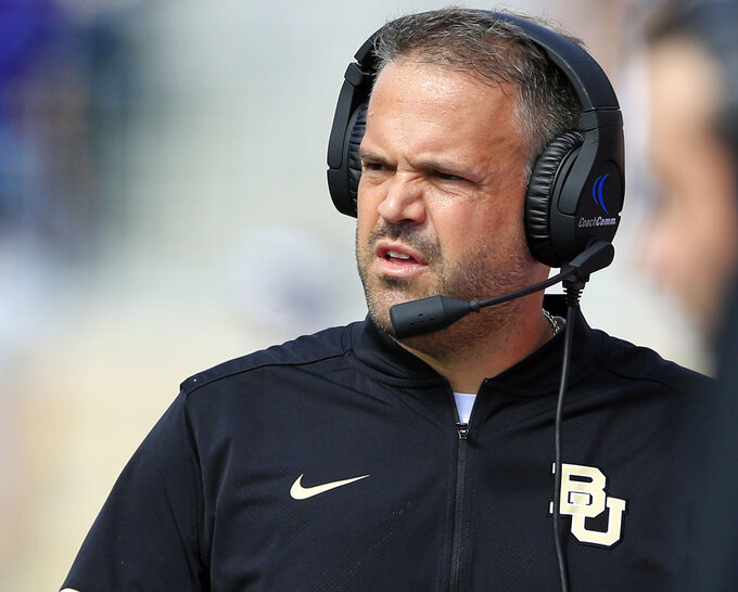 FILE - In this Sept. 30, 2017, file photo, Baylor head coach Matt Rhule watches from the sideline during the first half of an NCAA college football game against Kansas State, in Manhattan, Kan. Baylor coach Matt Rhule is more interested in what his team and the seniors who stuck around can accomplish, and not what the Bears could do to Big 12 rival TCU in the process. (AP Photo/Orlin Wagner, File)