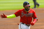 Atlanta Braves' Marcell Ozuna runs the bases on a home run during the first inning of a baseball game against the Boston Red Sox, Sunday, Sept. 27, 2020, in Atlanta. (AP Photo/John Amis)