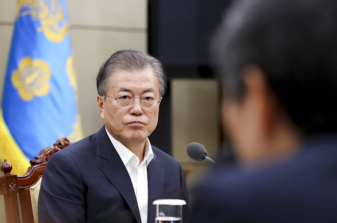 In this photo provided by South Korea Presidential Blue House, South Korean President Moon Jae-in listens a report from officials about the General Security of Military Information Agreement, or GSOMIA, at the Presidential Blue House in Seoul, South Korea, Thursday, Aug. 22, 2019.  South Korea will stop exchanging classified intelligence on North Korea with Japan amid a bitter trade dispute, an official said Thursday, a surprise announcement that is likely to set back U.S. efforts to bolster security cooperation with two of its most important allies in the Asian region. (South Korea Presidential Blue House via AP)