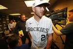 Colorado Rockies shortstop Trevor Story leaves a news conference held as part of the team's fan festival in Coors Field, Saturday, Jan. 25, 2020, in Denver. The Rockies are preparing for the opening of spring training. (AP Photo/David Zalubowski)