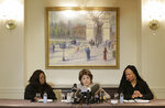 Attorney Gloria Allred, center, speaks while Latresa Scaff, right, and Rochelle Washington look on during a news conference in New York, Thursday, Feb. 21, 2019. Scaff and Washington are accusing musician R. Kelly of sexual misconduct on the night they attended his concert while they were teenagers. (AP Photo/Seth Wenig)