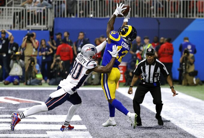 New England Patriots' Jason McCourty (30) breaks up a pass intended for Los Angeles Rams' Brandin Cooks (12) during the second half of the NFL Super Bowl 53 football game Sunday, Feb. 3, 2019, in Atlanta. (AP Photo/David J. Phillip)