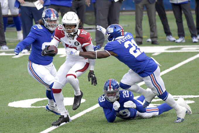 Arizona Cardinals' DeAndre Hopkins (10), second from left, tries to escape the New York Giants defense during the first half of an NFL football game, Sunday, Dec. 13, 2020, in East Rutherford, N.J. (AP Photo/Bill Kostroun)