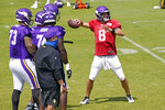 Minnesota Vikings quarterback Kirk Cousins (8) throws during the NFL football team's training camp Friday, Aug. 21, 2020, in Eagan, Minn. (AP Photo/Jim Mone)