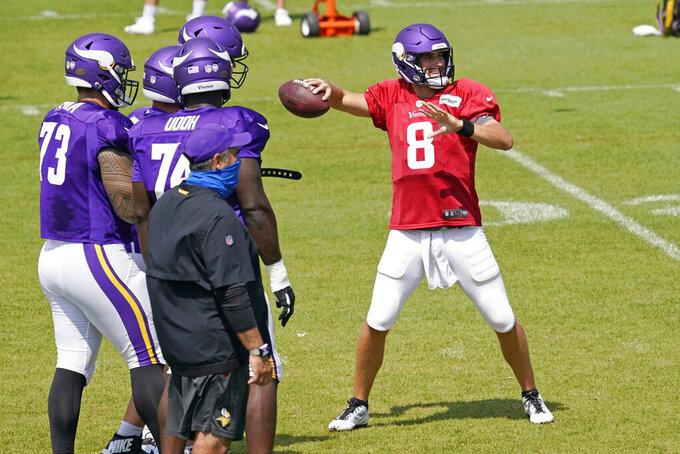 Minnesota Vikings quarterback Kirk Cousins (8) throws during the NFL football team's training camp Friday, Aug. 21, 2020, in Eagan, Minn. (AP Photo/Jim Mone)