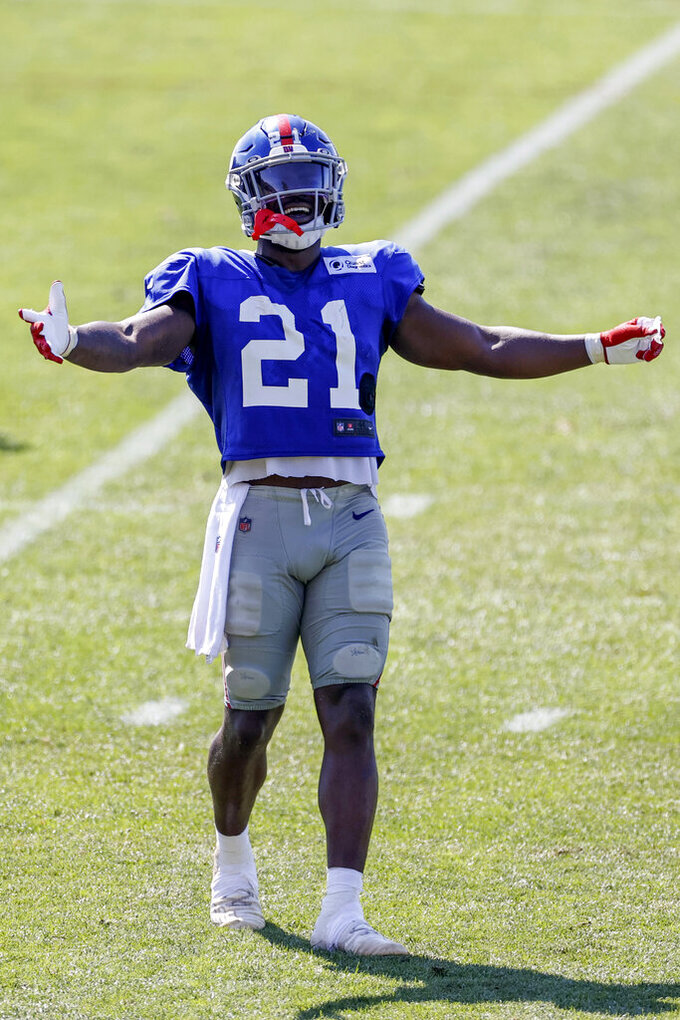New York Giants free safety Jabrill Peppers reacts to the Cleveland Browns bench after a play during a joint NFL football training camp practice Friday, Aug. 20, 2021, in Berea, Ohio. (AP Photo/Ron Schwane)