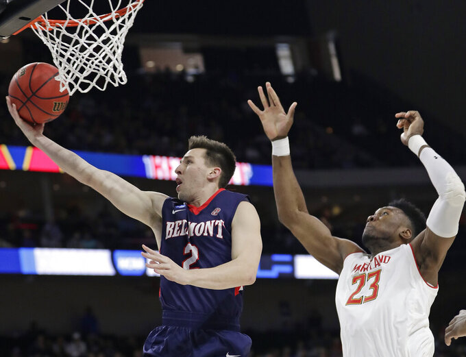 Belmont guard Grayson Murphy (2) gets off a shot ahead of Maryland 's Bruno Fernando (23) during the first half of a first round men's college basketball game in the NCAA Tournament in Jacksonville, Fla., Thursday, March 21, 2019. (AP Photo/John Raoux)
